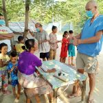 volunteer in cambodia atmedical-charity-in-siem-reap-checking-blood-pressure